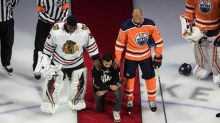Minnesota Wild defenceman Matt Dumba kneels for American anthem