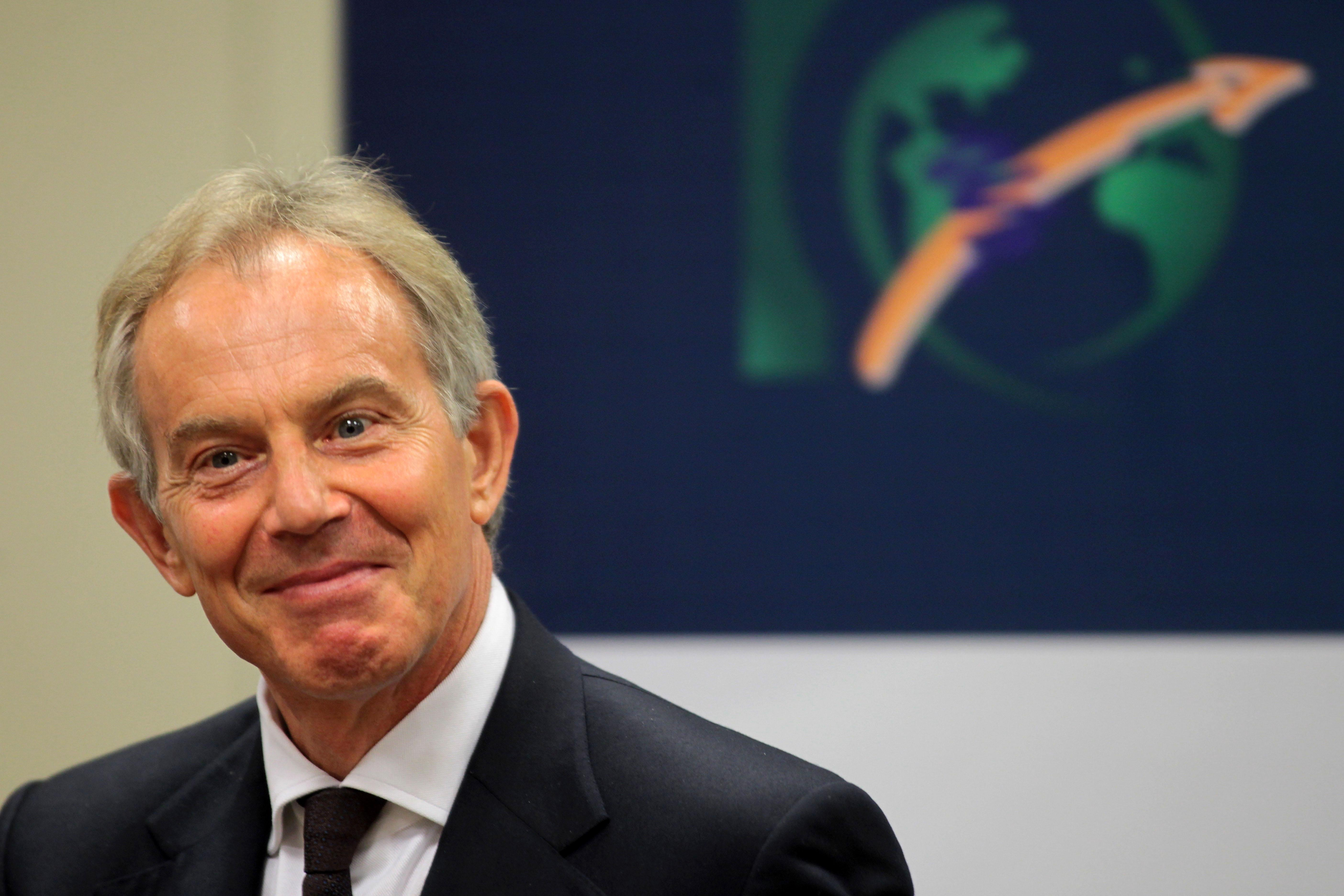 Former British Prime Minister Tony Blair smiles as he delivers a speech during a meeting of the Competitive Brazil Movement, MBC, in Brasilia, Brazil, Tuesday, Aug. 28, 2012. (AP Photo/Eraldo Peres)