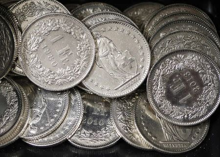 One Swiss franc coins are seen in a cash drawer in this picture illustration in Bern