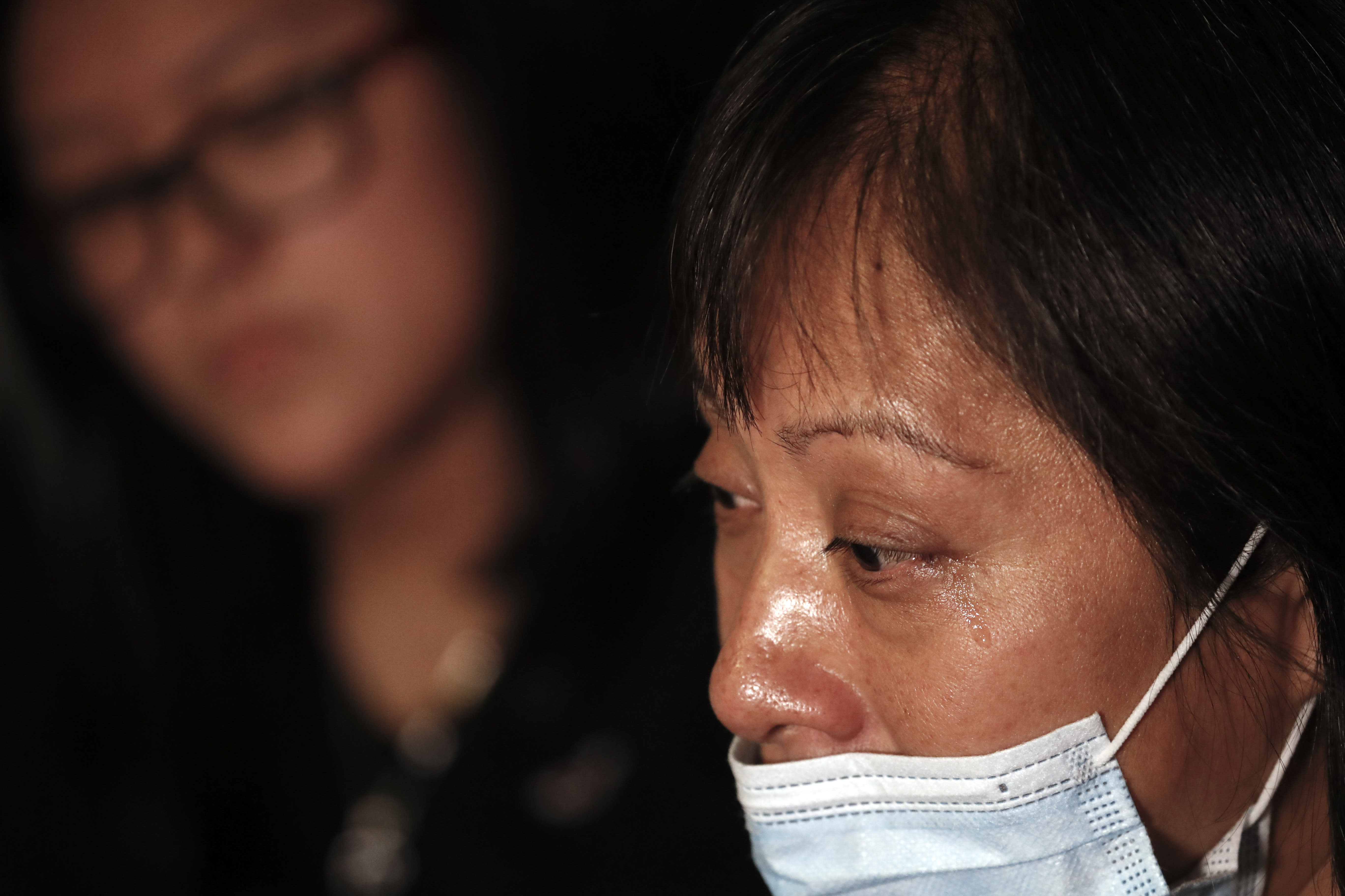 """Magnolia Ortega cries during an interview at home in Staten Island, New York, Wednesday, June 24, 2020, as she explains her bout with cancer and the fear of never seeing her daughters again. Ortega, whose cancer is in remission, says she's considering returning to her hometown of San Jeronimo Xayacatlan, Mexico but says there's no work there and that would mean one less family member sending back one less monthly check. """"If I go back,"""" she said, """"we won't have anything.'' (AP Photo/John Minchillo)"""