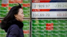 Global shares mixed after US break, investors eye Fed notes