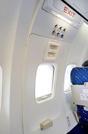 """<span class=""""aol-df-slide-caption-desc""""><a href=""""http://travel.aol.co.uk/2011/05/15/terror-as-passenger-tries-to-open-door-of-easyjet-plane-at-35-000ft/"""" target=""""_blank"""">Terrified passengers on board an easyJet plane had to overpower a man who twice attempted to open a cabin door mid-flight at 35,000ft</a>. The man, in his 40s, became agitated during the flight from Krakow to Edinburgh and started pacing up and down the aisles while clutching onto a flight safety instruction card, which detailed how to open the exit during an emergency situation. He then put on his rucksack and lunged for the door handle before being tackled by cabin crew and passengers and forcing an emergency landing at Amsterdam Schiphol Airport.</span>"""