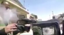 Journalist narrowly escapes death after GoPro is shot off his chest in Iraq