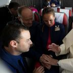 Pope performs first marriage on board a papal flight