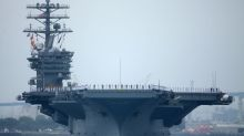 U.S. Navy carriers conduct South China Sea drills as Chinese ships watch