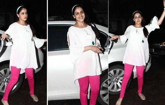 Tunics The white tunic top not just strikes a style statement but also provides plenty of room for the growing belly. Genelia paired her tunics with fuchsia pink leggings and flat slippers.