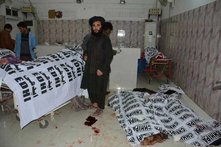 Paramedics gather around the bodies of blast victims at a hospital in Quetta following an explosion at a mosque (AFP Photo/BANARAS KHAN)