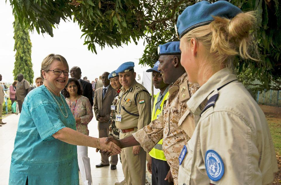 New UNMISS mission head Ellen Margrethe Loj (L) is greeted by UNMISS personnel as she arrives in Juba on September 2, 2014
