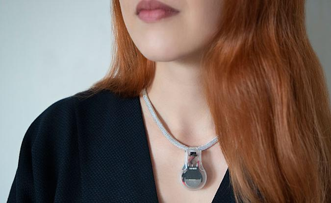 A woman wearing NASA's Pulse necklace