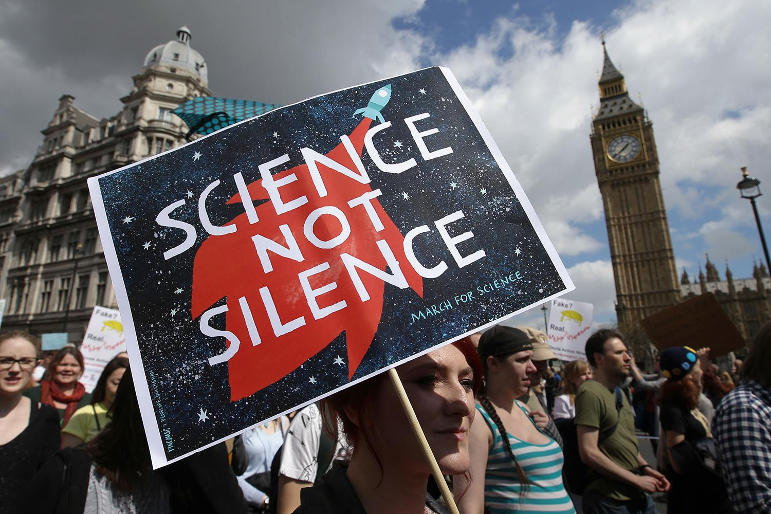 <p>A protestor holds a placard as scientists and science enthusiasts participate in the 'March for Science' which celebrates the scientific method, in Westminster, central London on April 22, 2017, Earth Day. (Daniel Leal-Olivas/AFP/Getty Images) </p>