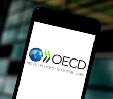 OECD adds risk of COVID-19 'double-hit' in bleak economic forecasts