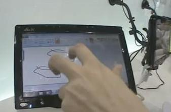 Swiveling ASUS Eee PC T91 does multitouch in Windows 7