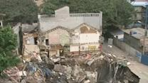 Raw: Giant Sinkhole Gobbles Up Building in China