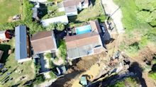 House left teetering on edge of cliff after rock collapse forces evacuation of 20 homes