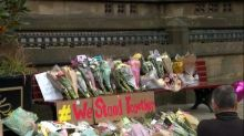 Manchester residents mourn as information on the suspected bomber comes to light