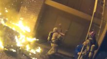 Pulse-Pounding Rescue Caught on Tape as Firefighters Catch Baby Tossed From Burning Building