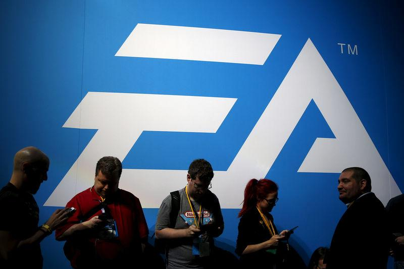 an electronic arts ea video game logo is seen at the electronic entertainment expo - signups for fortnite