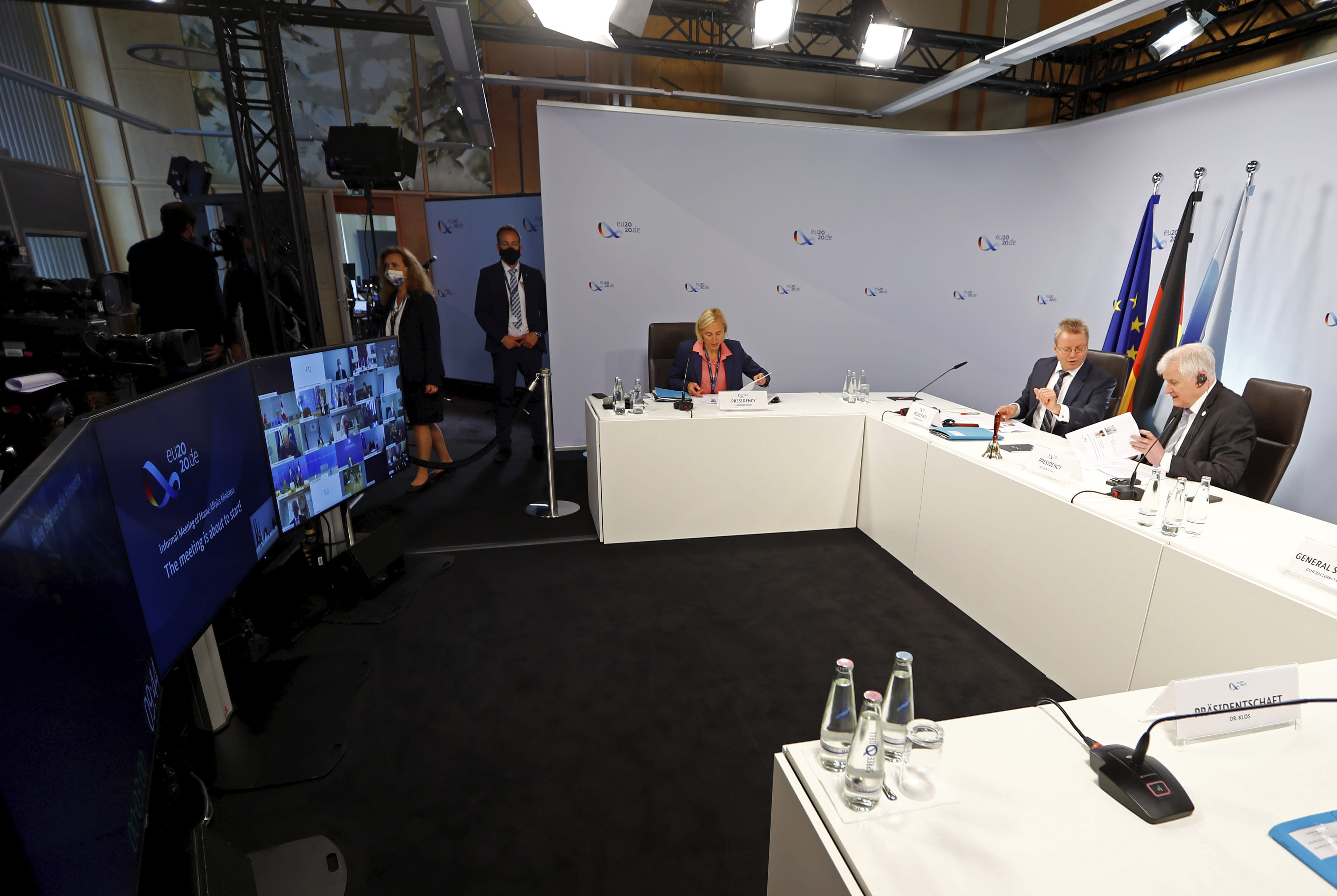 Federal Minister of the Interior Horst Seehofer (r, CSU) is hosting a virtual meeting with the European justice and interior ministers in the context of the German EU Council Presidency due to the Corona crisis in Berlin, Germany, Tuesday, July 7, 2020. (Fabrizio Bensch/Pool via AP)