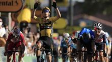 Wout van Aert wins explosive Tour stage as Yates holds on to yellow jersey