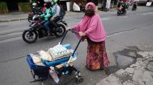 Indonesia reports 84 new virus deaths