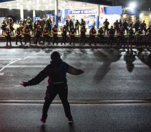 Police try to disperse curfew-defying crowds in second night of Daunte Wright protests