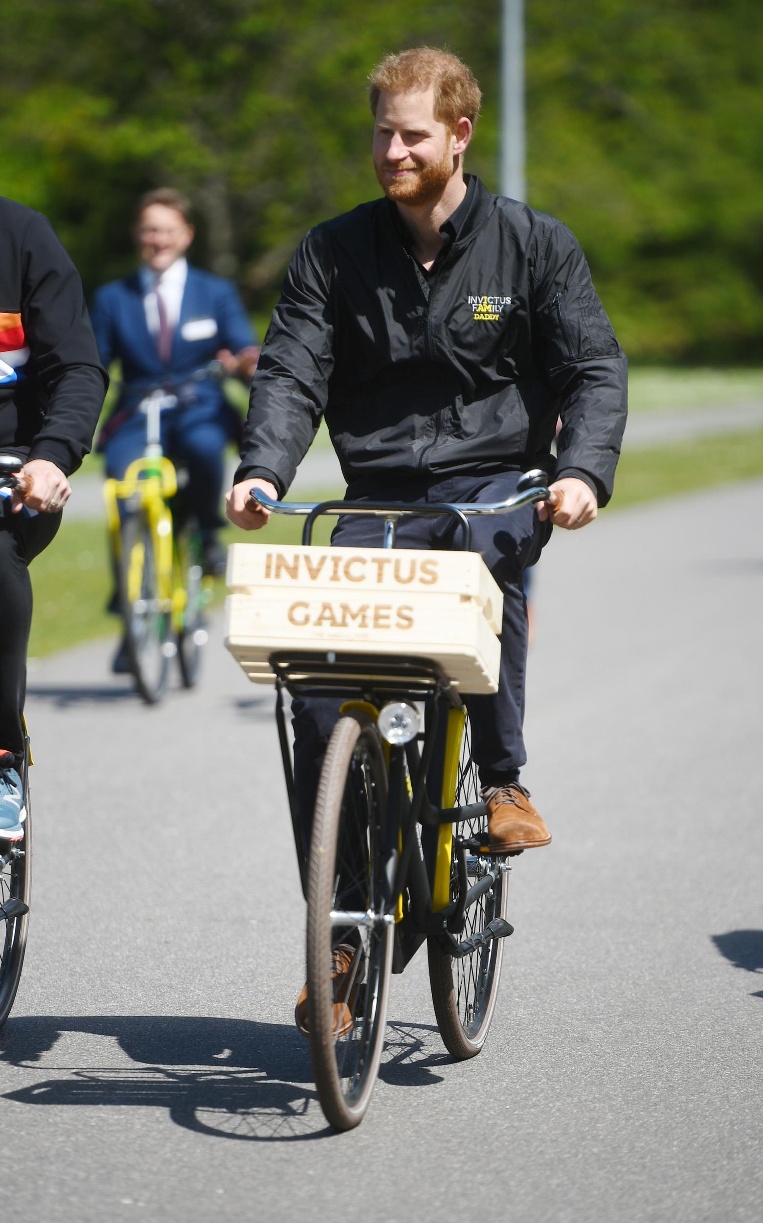 The Duke of Sussex rides a bicycle during events to launch the one year countdown to next year's Invictus Games in the Hague, in the Netherlands. (Photo by Kirsty O'Connor/PA Images via Getty Images)