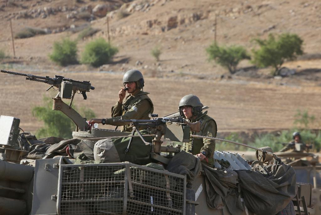 Israeli soldiers ride a howitzer tank during a military exercise near Nablus, in the Israeli-occupied West Bank