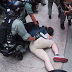 Man Knocked to the Ground During Hong Kong Protests
