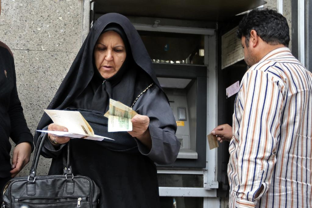 """Iran's economy had plenty of problems even before US President Donald Trump decided in May to abandon the 2015 nuclear deal and reimpose """"crippling"""" sanctions (AFP Photo/ATTA KENARE)"""