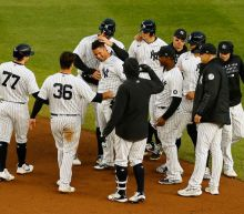 Yankees rally for 11-inning win over Nationals
