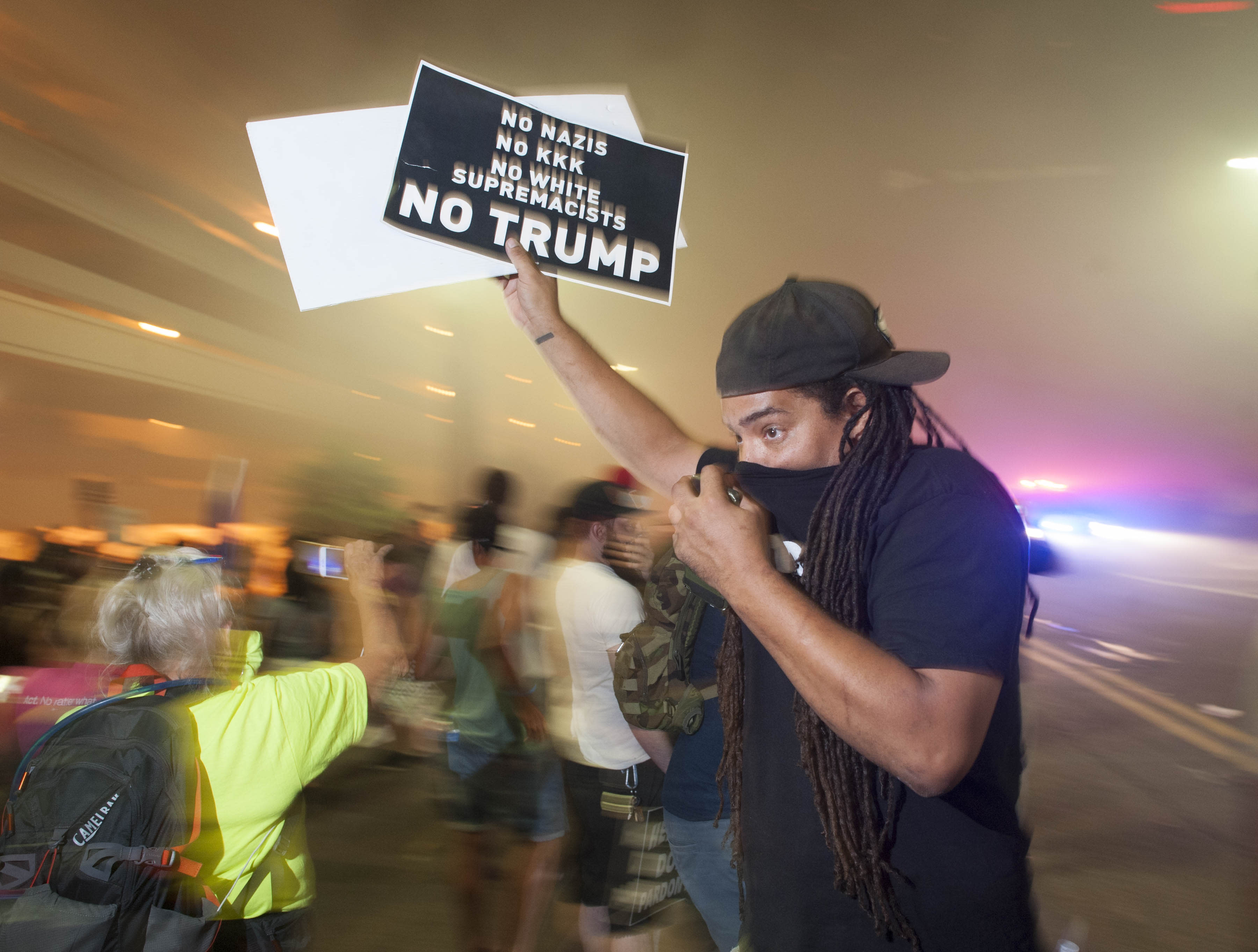 """<p>Police use pepper spray to break up protesters gathered outside of the Phoenix, Arizona, Convention Center where US President Donald Trump spoke at a """"Make America Great Again"""" rally on August 22, 2017. (Laura Segall/AFP/Getty Images) </p>"""