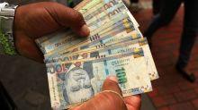 Monedas caen frente al dólar, real de Brasil lidera pérdidas