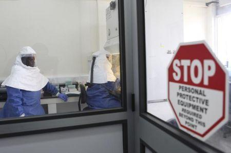 Doctors work in a laboratory on collected samples of the Ebola virus at the Centre for Disease Control in Entebbe