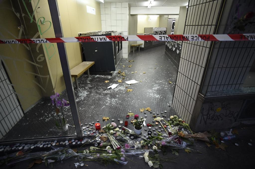 A makeshift memorial in tribute to the victims of the Paris attacks, at a launderette near the site of one of the attacks