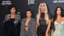 Kim and Kourtney Kardashian's awkward red carpet moment at the People's Choice Awards