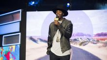 Canadian celebrity Kardinal Offishall calls out Air Canada for being overcharged and kicked out of his seat