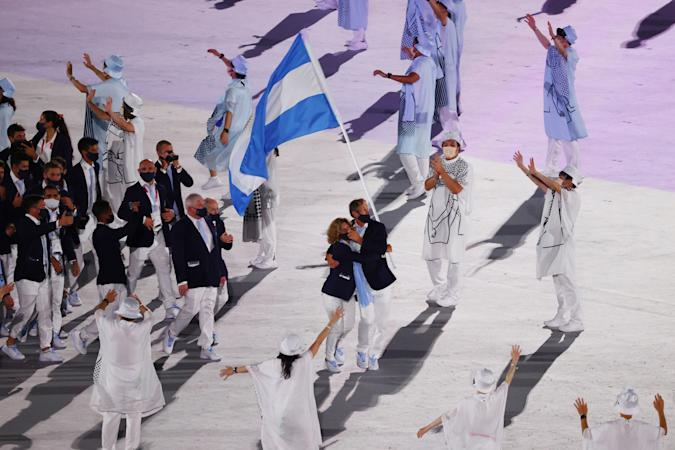 Tokyo 2020 Olympics - The Tokyo 2020 Olympics Opening Ceremony - Olympic Stadium, Tokyo, Japan - July 23, 2021.  Cecilia Carranza of Argentina and Santiago Lange of Argentina lead their contingent in the athletes parade during the opening ceremony REUTERS/Pilar Olivares
