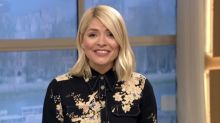 Holly Willoughby presents 'This Morning' alone as she reveals Phillip Schofield is 'not well'