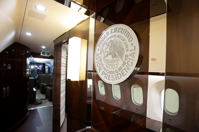 FILE PHOTO: Mexico's official government seal is seen on a wall of the Mexican Air Force Presidential Boeing 787-8 Dreamliner during a media tour before is put up for sale by Mexico's new President, at Benito Juarez International Airport in Mexico City