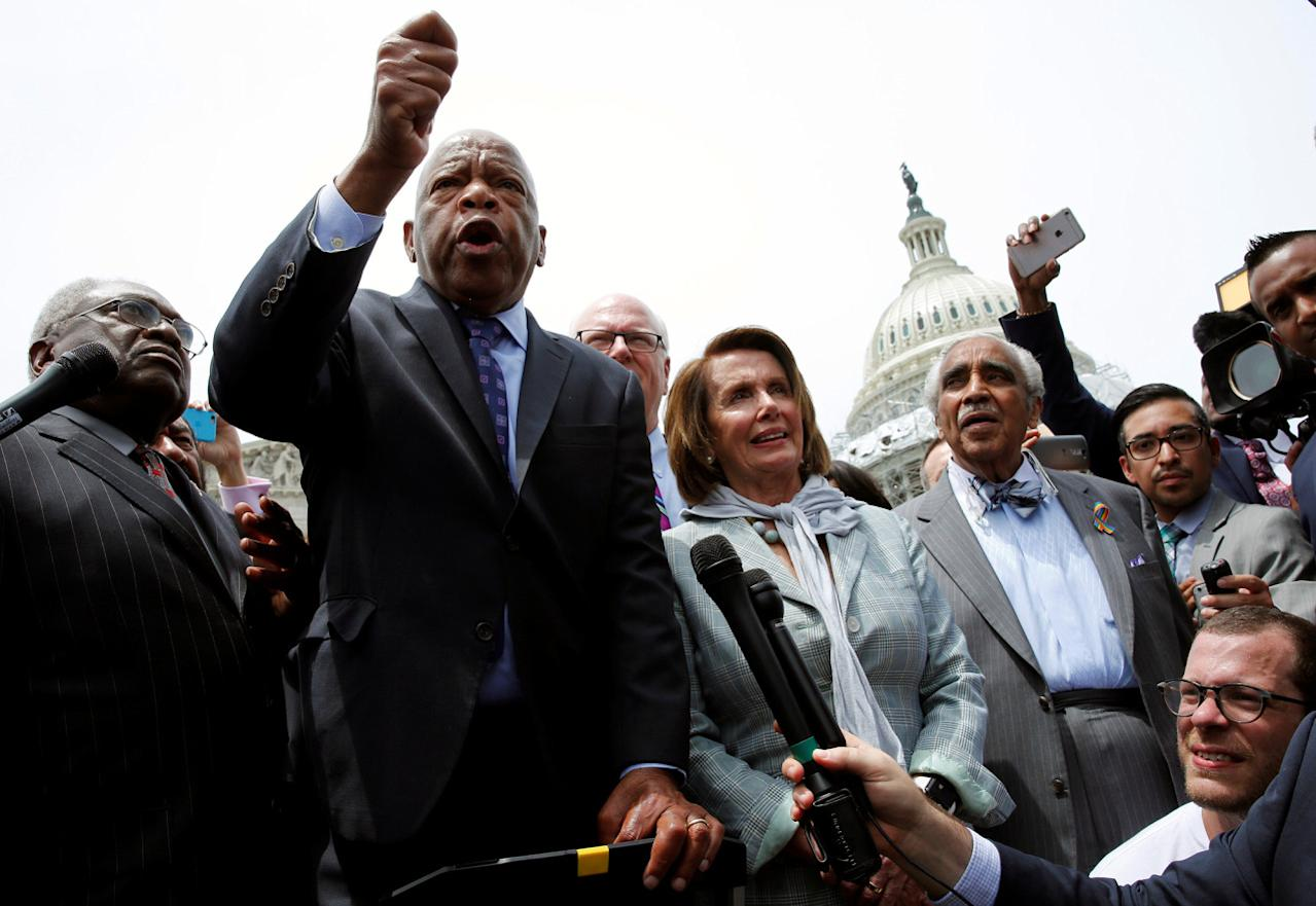 <p>Rep. John Lewis (2nd L) talks to supporters along with House Democrats after their sit-in over gun-control law on Capitol Hill in Washington, June 23, 2016. (REUTERS/Yuri Gripas) </p>
