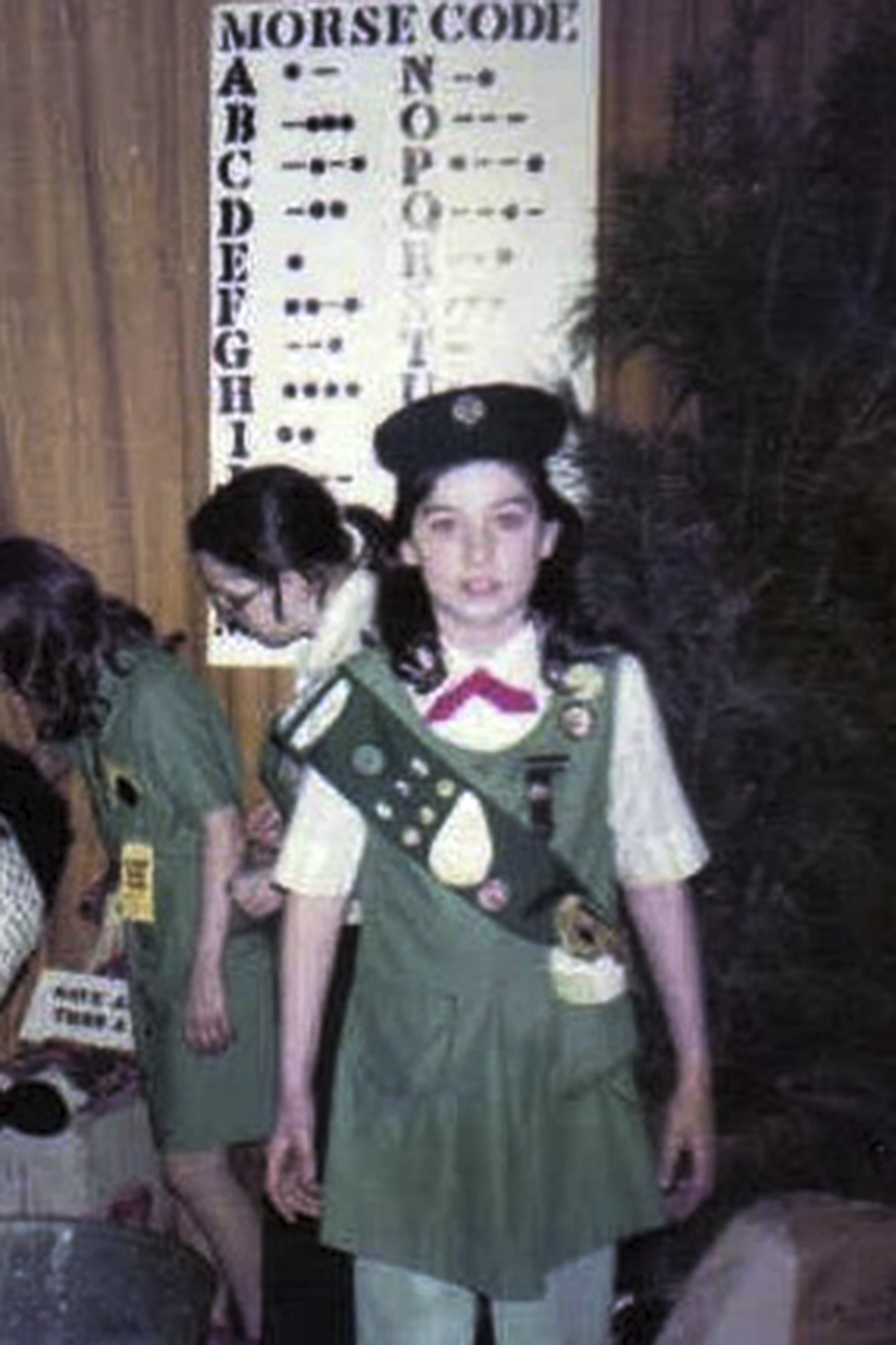 """This 1982 photo, provided in New York, Tuesday Aug. 4, 2020, shows Girl Scout Alice Weiss-Russell, age 11. As a Girl Scout growing up in upstate New York, Alice Weiss-Russell says she lived with a dark secret: The husband of her troop leader was sexually abusing her in the bathroom of a church basement where scout meetings were held in the 1980s. She has detailed her alleged ordeal in a new lawsuit filed against Girl Scouts of the USA, part of a flurry of child sex-abuse cases in New York using a """"look back window"""" for making civil claims against abusers.(Courtesy Alice Weiss-Russell via AP )"""