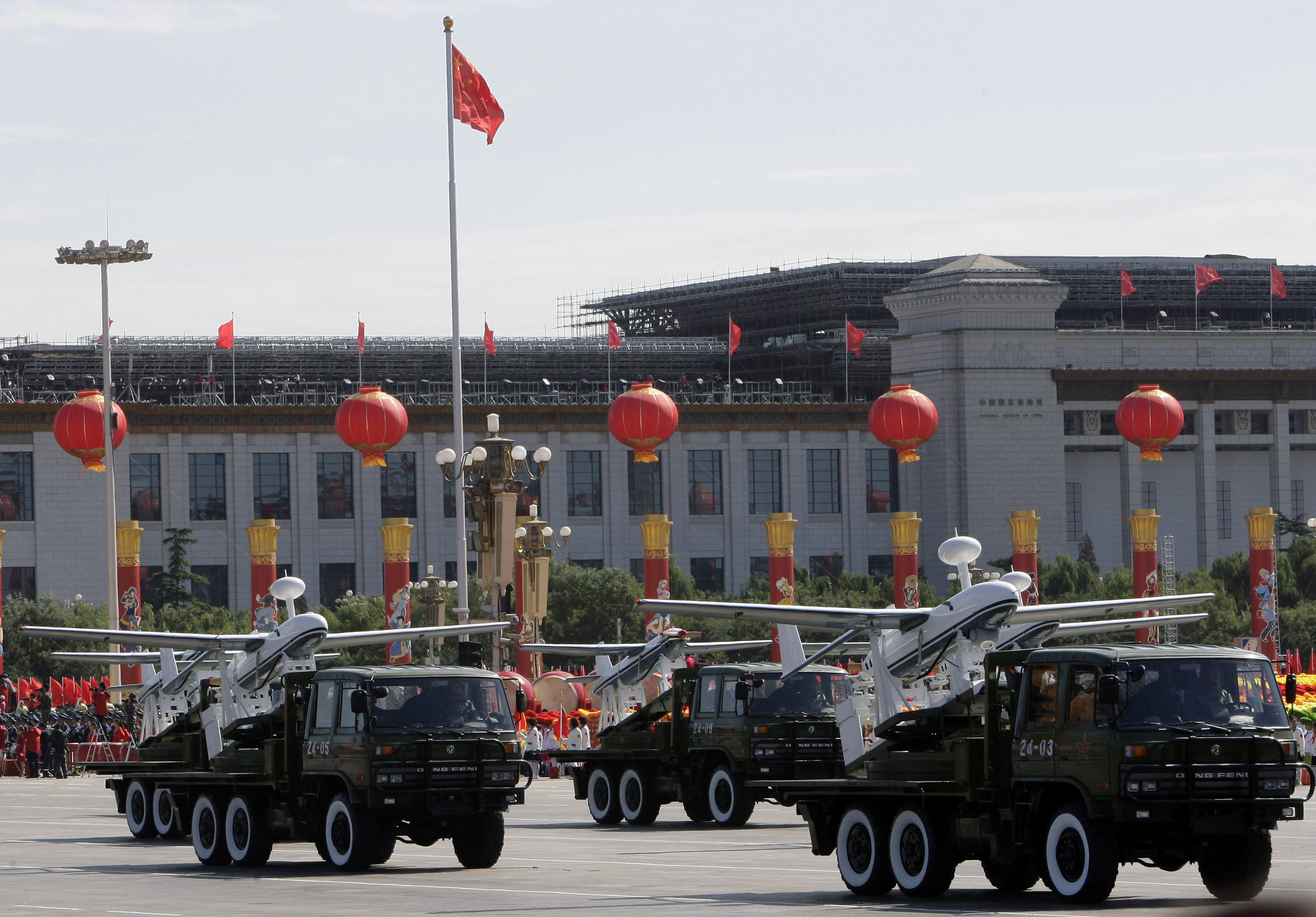 FILE - In this Oct. 1, 2009 file photo, trucks loaded with the Chinese made drones, the ASN-207, take part in a military parade marking China's 60th anniversary held near Tiananmen Square in Beijing. Chinese aerospace firms developed dozens of drones, known also as unmanned aerial vehicles, or UAVs. Many have appeared at air shows and military parades, including some that bear an uncanny resemblance to the Predator, Global Hawk and Reaper models used with deadly effect by the U.S. Air Force and CIA. Analysts say that although China still trails the U.S. and Israel, the industry leaders, its technology is maturing rapidly and on the cusp of widespread use for surveillance and combat strikes. (AP Photo/Vincent Thian, File)