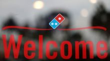Domino's cuts cost outlook after third-party delivery hit