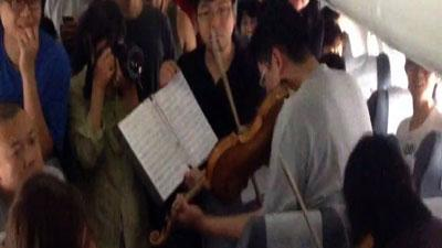 Raw: Philly Orchestra Performs on Delayed Plane