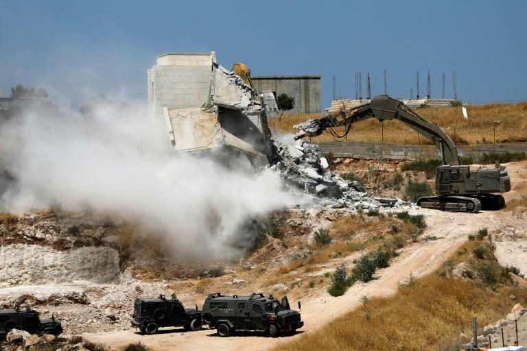Israel rarely grants approvals for Palestinian construction in the more than 60 percent of the West Bank under its civil as well as security control and frequently carries out demolitions of Palestinian buildings it considers illegally built (AFP Photo/Ahmad GHARABLI)