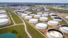 Oil flat as weaker dollar offsets surge in U.S. gasoline stocks