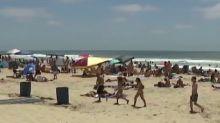 Crowds seen packing beaches amid coronavirus pandemic
