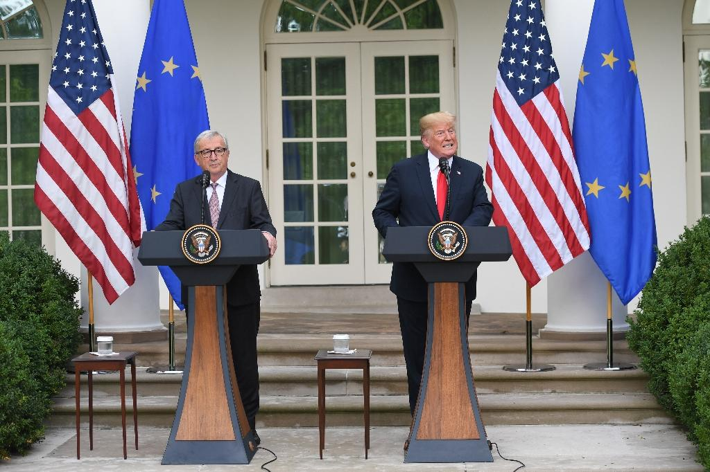 US President Donald Trump and European Commission chief Jean-Claude Juncker, seen here after White House talks, have moved to defuse trade row (AFP Photo/SAUL LOEB)
