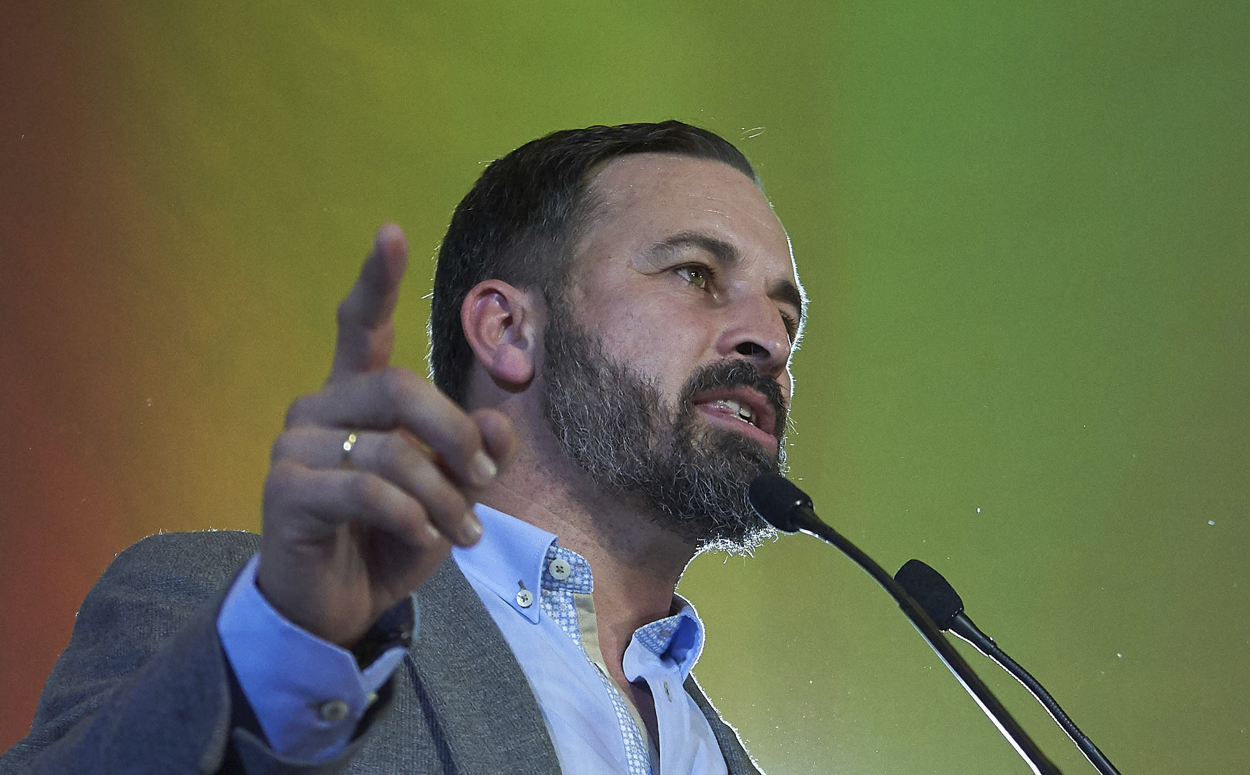 In this Sunday, Dec. 2, 2018 photo, Spain's far-right Vox Party President Santiago Abascal, takes part in a rally during regional elections in Andalusia, in Seville, Spain. The Socialists won just 33 seats in the Andalusia legislature, compared to 47 in 2015. The party could lose control of Spain's most populated region for the first time in 36 years if parties on the right can agree to form a government. The anti-immigrant, extreme right Vox party won 12 seats - its first in any Spanish legislative body. (AP Photo/Gogo Lobato)