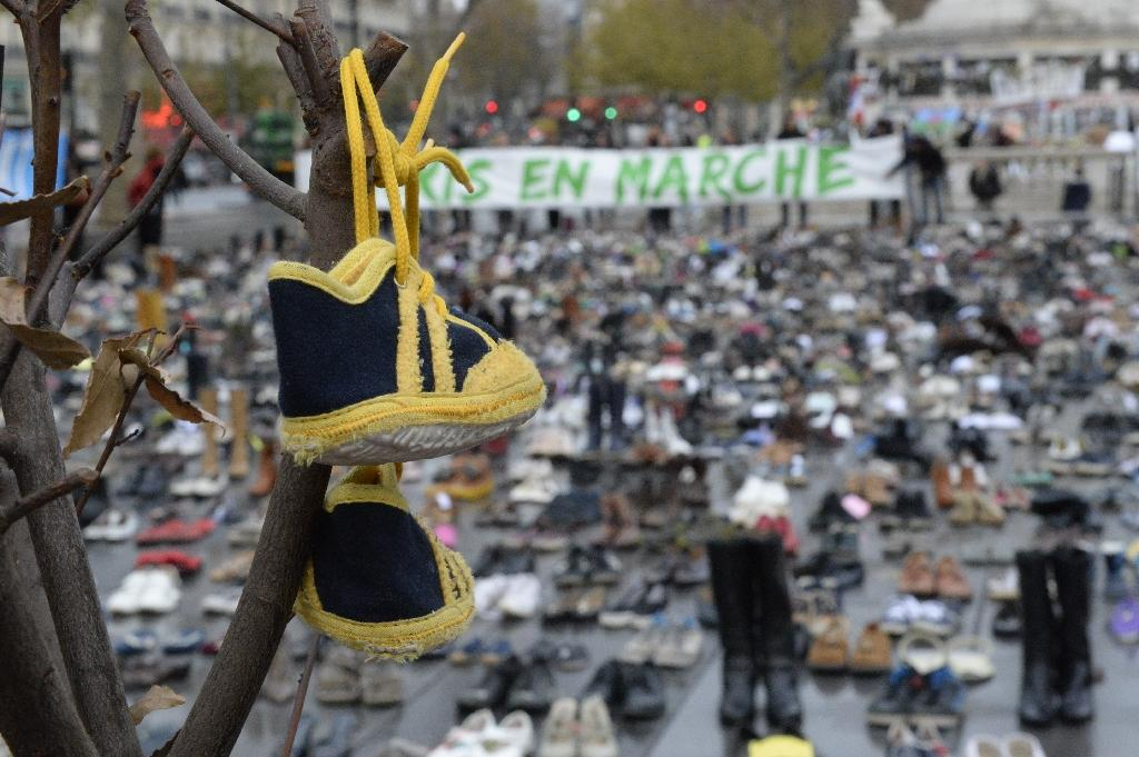 Some activists in Paris on November 29, 2015, instead of marching, have piled up thousands of pairs of shoes in the Place de la Republique -- one way to rally regardless of the ban on public gatherings in place since the terror attacks on the city (AFP Photo/Miguel Medina)